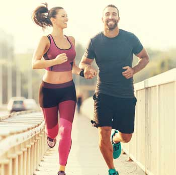 man and woman running boosting metabolism and losing weight